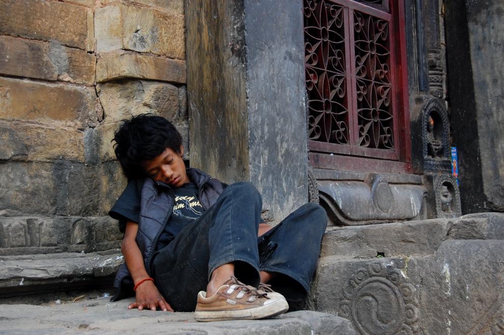 Nepali boy sleeping in Durbar Square in Kathmandu.